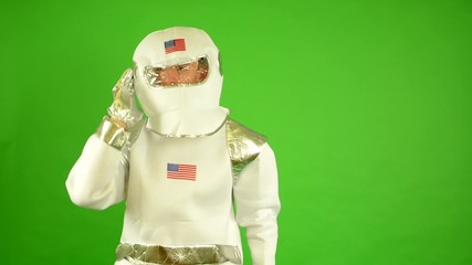 astronaut calls by walkie-talkie - green screen