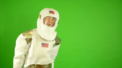 astronaut waves with hand - green screen