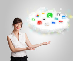 Young woman presenting cloud with colorful app icons and symbols