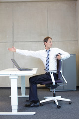 exercises in office. business man  stretching.