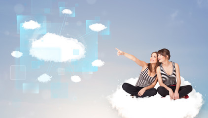 Happy girls looking at modern cloud network