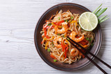 Rice noodles with shrimps and vegetables top view - 73980751