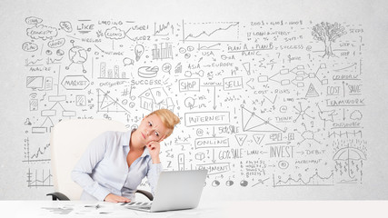 Pretty businesswoman planning and calculating various business i