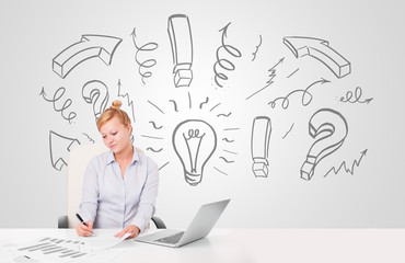 Attractive businesswoman brainstorming with drawn arrows and sym