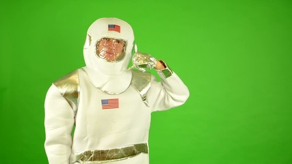 astronaut - concept: telephone call - green screen