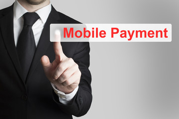 businessman pushing flat button mobile payment