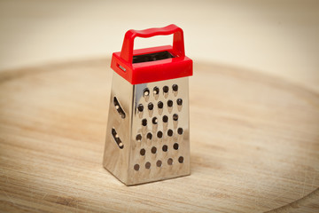 Grater on wooden table