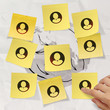 hand pushing sticky note social network icon on crumpled paper b