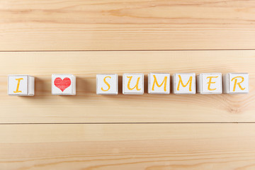 I love summer spelled in wooden blocks