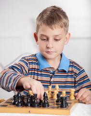 beautiful, caucasian boy playing chess