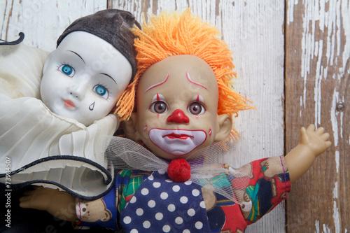 Sad old vintage dolls on wooden background - 73984507