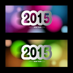 Happy New Year 2015 banners on blurred background with papercut