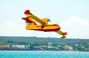 Aerial firefighting.  Aircraft preparing to collect sea water.