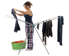 Red-haired girl drying clothes on clothesline isolated.