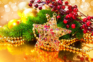 Christmas baubles and decorations over golden background