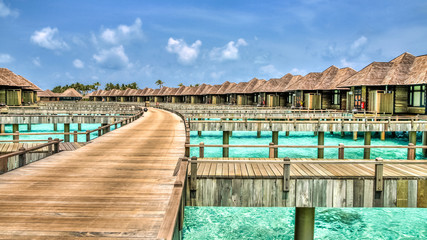 View of water bungalows in tropical paradise