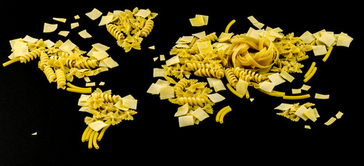 map of the world made of raw pasta on black background