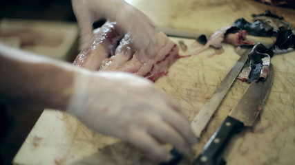 Fish production guys undress a body of big swordfish