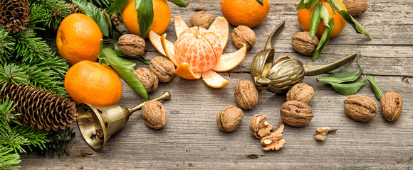 mandarin fruits and walnuts with christmas decorations