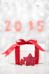 Christmas gift with new Year 2015 in backgroungd blured
