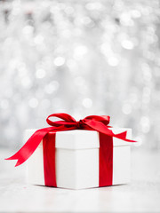 Christmas Gift packed in white box with red ribbon