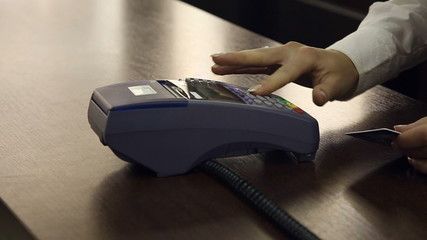 Credit card payment terminal in store.
