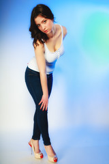 plus size woman in casual clothes posing in studio