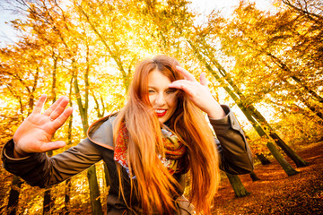 Unusual angle of young woman in autumn park