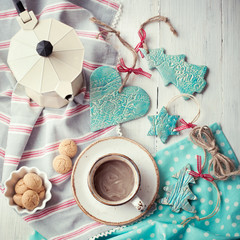 Cup of espresso and Christmas decorations on a wooden table