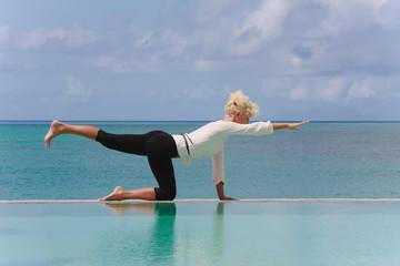 yoga by infinity pool