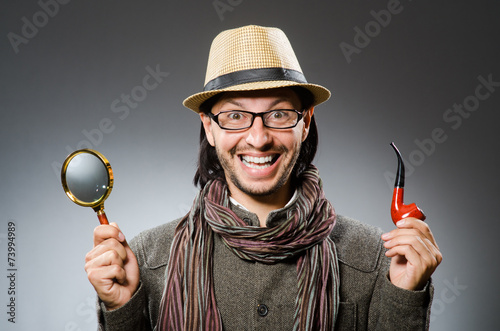 Funny detective with smoking pipe and magnifying glass Poster