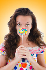 Woman with lollipops isolated on white