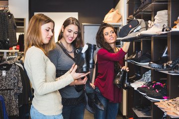 Women Buying Shoes in a Store