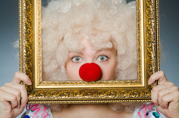 Funny clown with picture frame