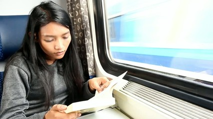 woman read her book while train