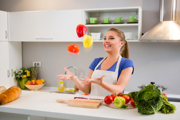 Young woman  juggle with vegetables