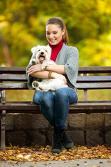 girl and her dog maltezer in a park