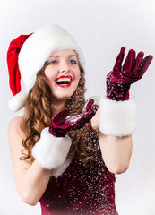 Happy female Santa enjoying a snowy Christmas