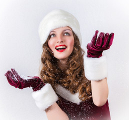 Happy female Santa enjoying a snowy Christmas