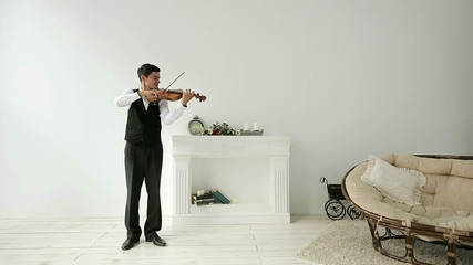 Latino violinist man on a white background.