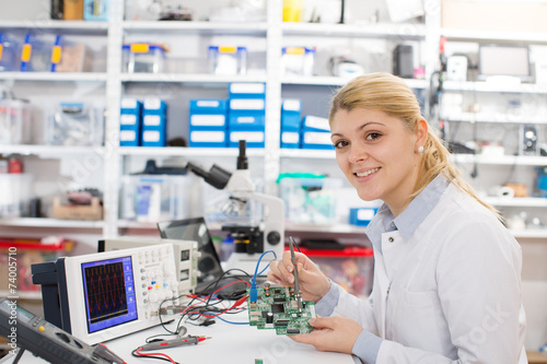 Leinwandbild Motiv girl student studying electronic device with a microprocessor