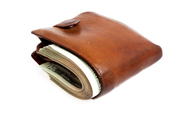 Old brown wallet with money on white background