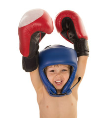little boy in boxing gloves and helmet