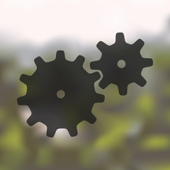 cogwheel icon on blurred background