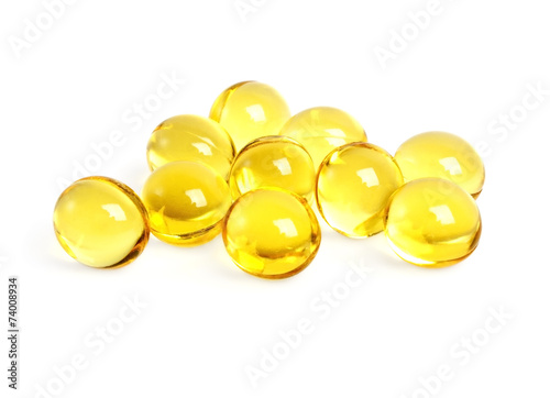 Cod liver oil omega 3 gel capsules on a white background - 74008934