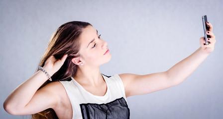 Teenager making selfie