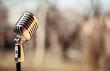 Leinwandbild Motiv Silver vintage microphone in the studio on blured background