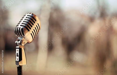 Silver vintage microphone in the studio on blured background - 74009701
