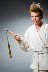 Funny karate fighter with nunchucks