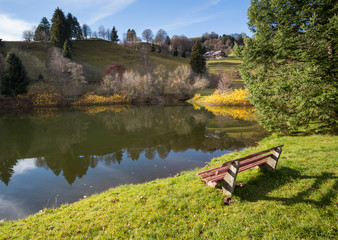 park bench at lake in black forest, Germany